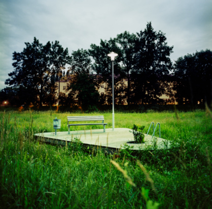 Focus On Background「bench on pedestal surrounded by grass in park at n」:スマホ壁紙(1)