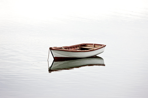 Remote Location「A small white dinghy rests at anchor in quiet water.」:スマホ壁紙(15)