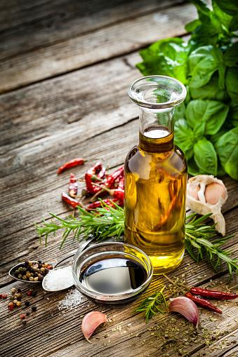 Vinaigrette Dressing「Italian ingredients: olive oil and balsamic vinegar on rustic table」:スマホ壁紙(0)
