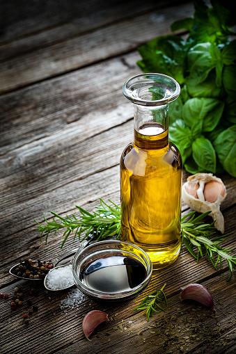 Vinaigrette Dressing「Italian ingredients: olive oil and balsamic vinegar on rustic table」:スマホ壁紙(4)