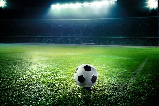 Floodlit「Soccer ball on sports field」:スマホ壁紙(16)