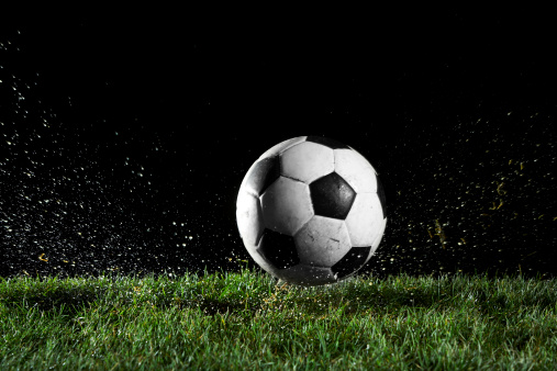 Sport「Soccer ball in motion over grass」:スマホ壁紙(12)