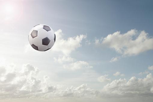 Soccer Ball「Soccer ball flying in cloudy sky」:スマホ壁紙(16)