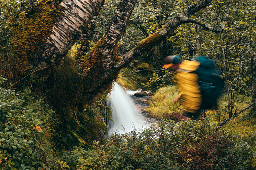 One Person「Camping in the wild. Drinking from a stream. Blurred motion」:スマホ壁紙(4)
