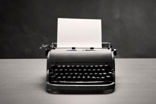 Typewriter「Moody film noir shot of vintage typewriter and blank paper」:スマホ壁紙(8)