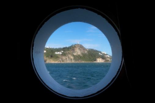 Porthole「View through cruiseship porthole of statue of Jesus Christ on hilltop.」:スマホ壁紙(13)