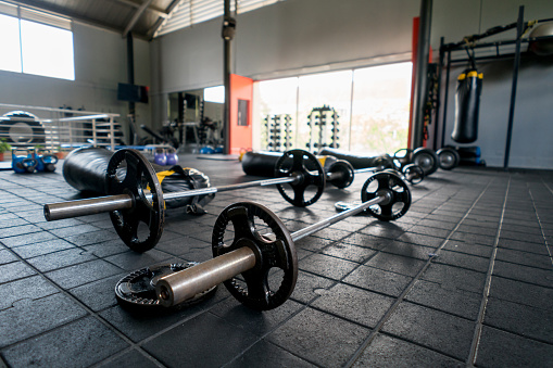 Sports Training「Sports facility with barbells punching bags, machines for functional training」:スマホ壁紙(9)