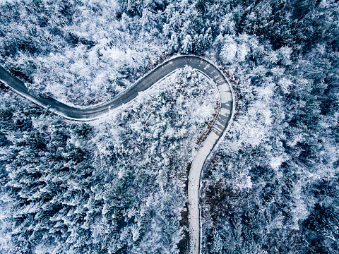 Switzerland「Mountain winding road with snow,aerial view」:スマホ壁紙(14)