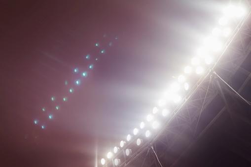 Rivalry「Stadium lights shining towards sky」:スマホ壁紙(7)