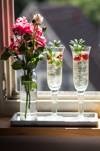 Berry Fruit「Two Champagne glasses of may wine with raspberries on window sill」:スマホ壁紙(16)
