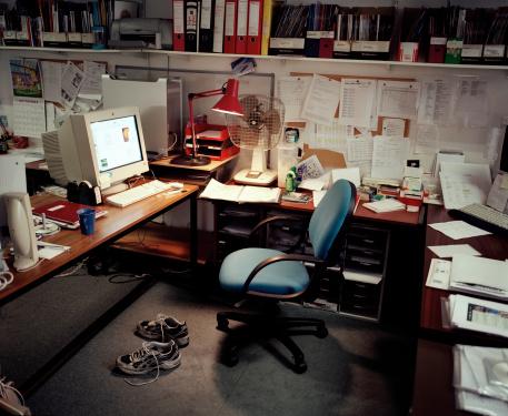 Shoe「Trainers on floor by empty chair in office」:スマホ壁紙(1)