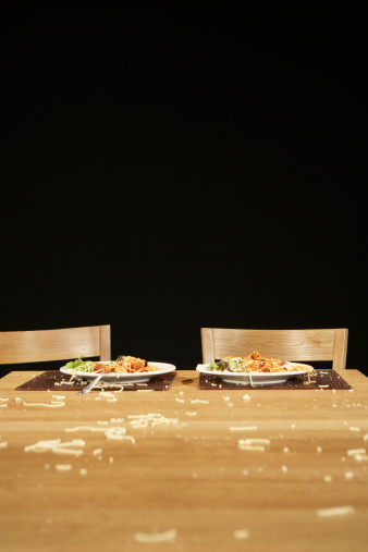 Dining Table「Two plates of pasta on table with bits of pasta covering tabletop」:スマホ壁紙(16)