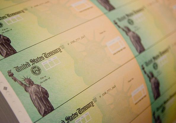 政治「Economic Stimulus Package Tax Rebate Checks Printed」:写真・画像(3)[壁紙.com]