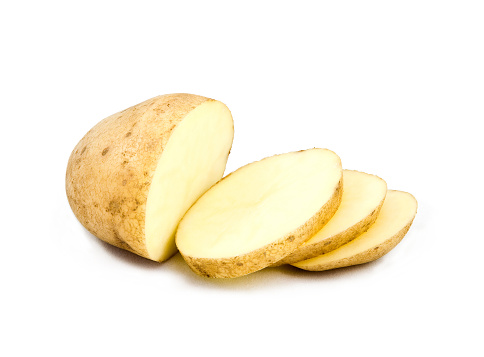 Raw Potato「A partially sliced potato on white」:スマホ壁紙(17)
