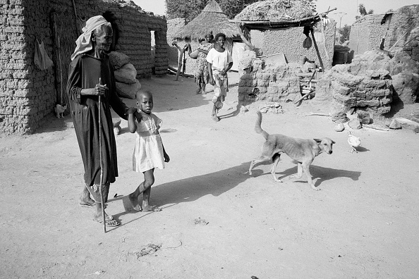 Part of a Series「Elderly woman  being led through her village by a young girl」:写真・画像(6)[壁紙.com]