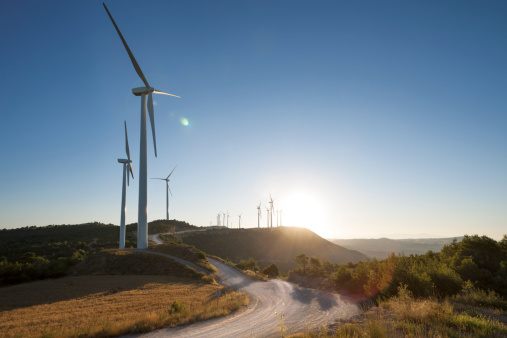 Wind Turbine「Curvy road through windmills at sunset」:スマホ壁紙(3)
