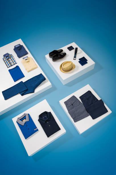 Men's clothing isolated on blue background:スマホ壁紙(壁紙.com)
