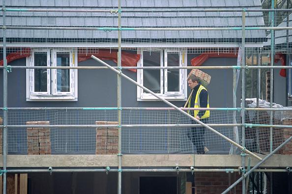 Brick Wall「Man working on the scaffolding of a residential development.」:写真・画像(12)[壁紙.com]