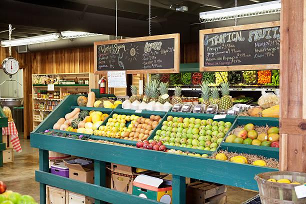 Fresh fruits stall with text on blackboard in supermarket:スマホ壁紙(壁紙.com)