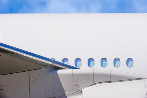 Aircraft Wing「Wing and windows on airplane」:スマホ壁紙(8)