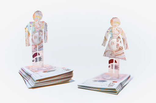 Employment And Labor「Male and Female Cut-out Figures on top of Bundles of Ten Pound Sterling Notes」:スマホ壁紙(9)