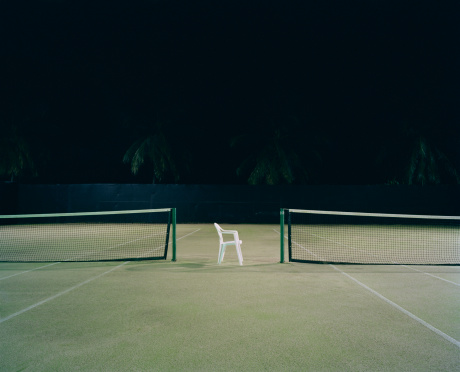 Carl Court「Plastic chair between two tennis courts, night」:スマホ壁紙(1)