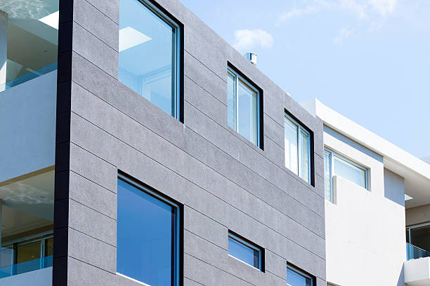Closeup modern apartment building against blue sky, copy space:スマホ壁紙(壁紙.com)