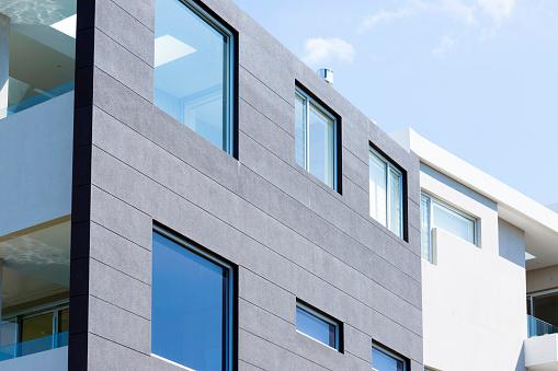 Blue「Closeup modern apartment building against blue sky, copy space」:スマホ壁紙(16)