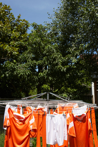 Soccer Uniform「Soccer uniforms hanging from clothesline outdoors」:スマホ壁紙(15)