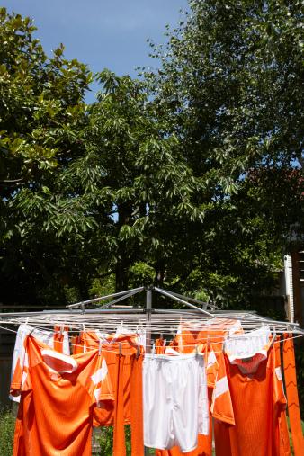 Soccer Uniform「Soccer uniforms hanging from clothesline outdoors」:スマホ壁紙(17)