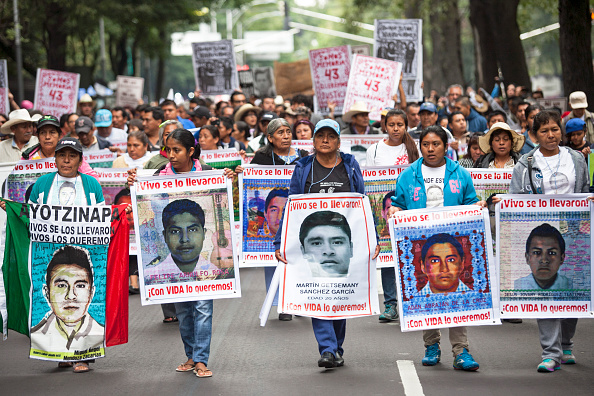 Mexico「Protest In Mexico City Marks One Year Anniversary Of Missing Students」:写真・画像(3)[壁紙.com]