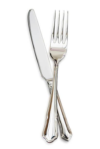 Silver fork sitting across a silver knife:スマホ壁紙(壁紙.com)