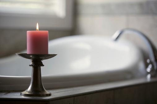 Candle「Pink candle burning beside bath tub in bathroom」:スマホ壁紙(13)