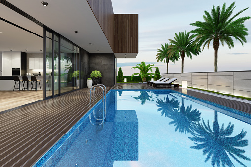 Standing Water「Luxurious beach side villa with swimming pool and palm trees at summer sunset scene」:スマホ壁紙(9)