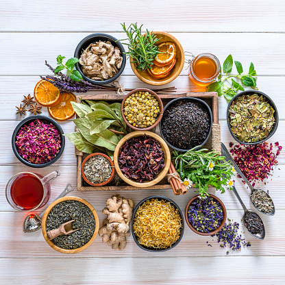 Spice「Large variety of multi colored dried tea leaves and flowers shot from above on white table」:スマホ壁紙(12)