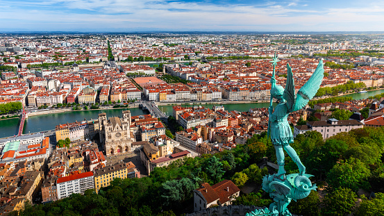 French Culture「Awesome aerial view on Lyon French cityscape viewed from the roofs of Basilica Notre Dame de Fourviere with Archangel Michael statue overlooking the city」:スマホ壁紙(8)
