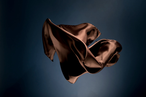 布「Floating brown satin on a dark blue background」:スマホ壁紙(1)