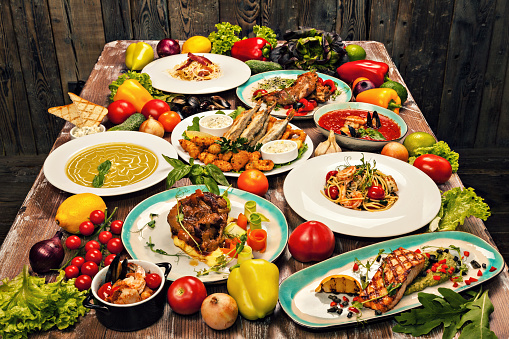 Banquet「Set of various dishes of Mediterranean cuisine, vegetables and herbs on a wooden table」:スマホ壁紙(14)