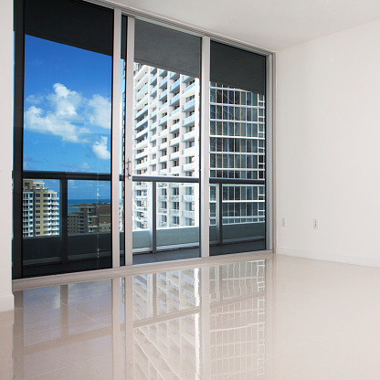 Gulf Coast States「Glass doors and balcony of empty modern apartment」:スマホ壁紙(14)