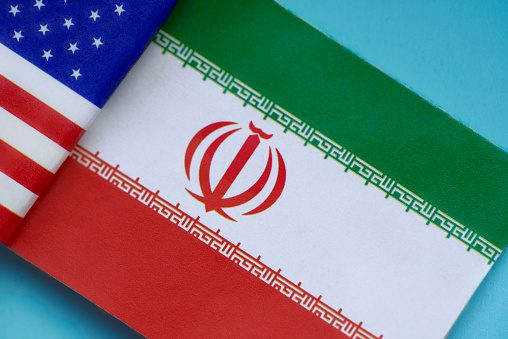 Iranian Culture「Iranian and U.S. Flags side by side, symbol of continuing conflict between Iran and the U.S.」:スマホ壁紙(13)
