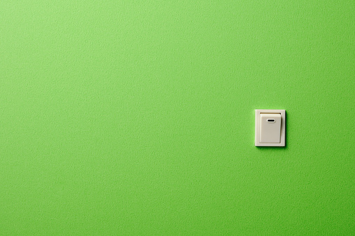 Start Button「ON OFF light switch on green wall with copy space」:スマホ壁紙(15)