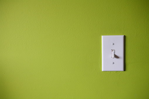 Light Switch「Light switch in front of green background」:スマホ壁紙(5)