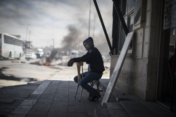 West Bank「Palestinians Clash With Israeli Military At Qalandia Checkpoint As They Mark Nakba Day」:写真・画像(12)[壁紙.com]