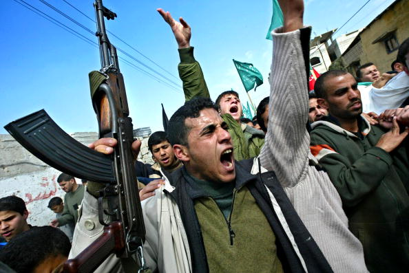 Arms Raised「Funerals In Gaza After Israeli Raid Kills Eight」:写真・画像(9)[壁紙.com]
