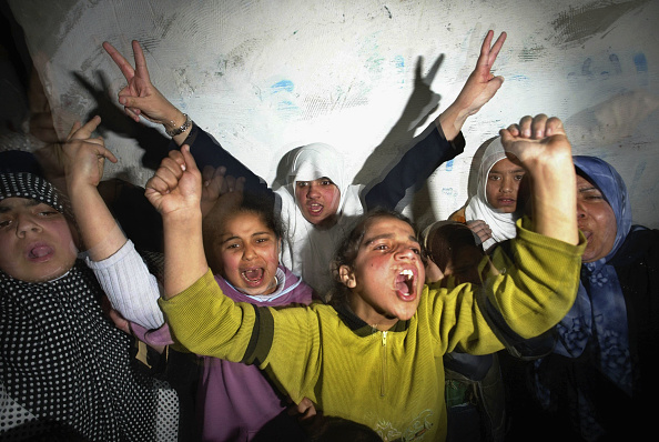 Front View「Palestinian Refugees Celebrate Double Suicide Attack」:写真・画像(18)[壁紙.com]