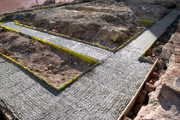 Pouring「Groundwork for house building. Trench reinforced with steel and concrete plastic spacers.」:写真・画像(6)[壁紙.com]