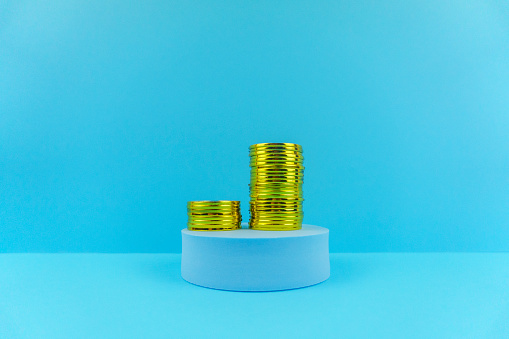 Economic fortune「Stack of Gold Coins on Blue Stage and Background.」:スマホ壁紙(7)