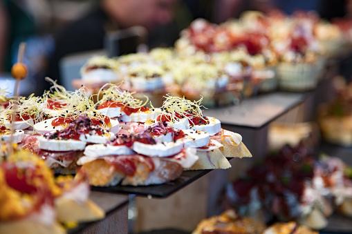 Consumerism「Famous Bilbao small sandwiches called pintxos server from a bar counter, Blibao」:スマホ壁紙(19)