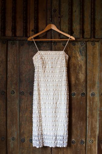 ドレス「Wedding dress hanging on a wooden door.」:スマホ壁紙(14)