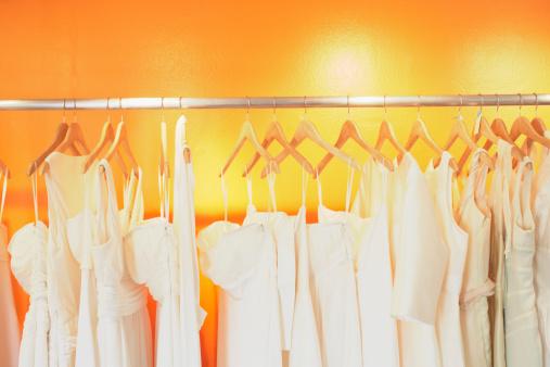 Yellow Dress「Wedding dresses on metal rack in clothing store」:スマホ壁紙(9)